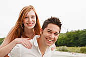 Young couple on bank of Isar river, Munich, Bavaria, Germany