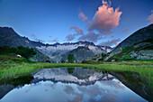Dammastock reflecting in mountain lake, Dammastock, Urner Alps, Uri, Switzerland