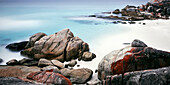 White sandy beach with crystal clear water, Bay of Fires around St. Helens, Tasmania, Australia, long time exposure, Pacific Ocean