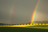 Rainbow with thunderclouds, Solling, Lower Saxony, Germany