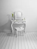 Dresser and stool in minimalist room
