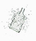 A glass Vodka bottle shattering, exploding. Close up of glass bottle shattering