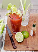 Cocktail with celery, lime and hot sauce. BloodyMary23.jpg, Lime, Hot Sauce, Celery, Tomato Juice