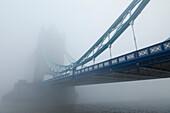UK, United Kingdom, Great Britain, Britain, England, London, Southwark, Tower Bridge, River Thames, Thames River, Thames, River, Rivers, Fog, Foggy, Mist, Misty, Weather, Moody, Tourism, Travel, Holiday, Vacation. UK, United Kingdom, Great Britain, Britai