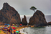 Spain, Europe, Catalonia, Costa Brava Coast, Tossa de Mar, town, Sa Mar Menuda Beach, beach, bright, coast, colourful, contrast, Costa Brava, light, Mediterranean, picturesque, pine tree, tossa, tourism, travel, umbrelas, vacation. Spain, Europe, Cataloni