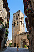 Street and bell tower of the romanesque church of Santa Maria, in Aínsa, a medieval village in Sobrarbe region, declarated Historical-Artistic Site  Huesca, Aragón, Spain