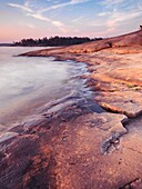 Landscape nature scenery of red rocks on a shore of Georgian Bay at dawn  Killbear Provincial Park, Ontario, Canada