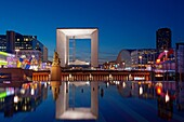 France, Paris, La Grande Arche de la Defense by architect Otto Von Spreckelsen at night