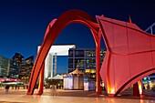 France, Paris, La Grande Arche de la Defense by architect Otto Von Spreckelsen and sculpture by Calder called The Red Spider on the esplanad at night