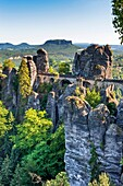 View from Ferdinand stone to the spectacular rock formation Bastei Bastion and Bastei Bridge It is one of the most visited tourist attractions in the Saxon Switzerland Behind it is the Table Mountain Lilienstein He is one of the most striking mountains in