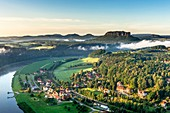 View to the Table Mountain Lilienstein in the national park Saxony Switzerland He is one of the most striking mountains in the Elbe Sandstone Mountains In front is the health resort Rathen Oberrathen at the Elbe River, Saxony, Germany, Europe