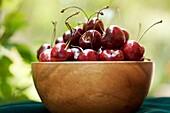 Red Cherries in Wooden Bowl