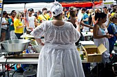 A food vendor fans herself at the 28th Annual Brazil Day Festival in New York The festival, which features food, music and other aspects of Brazilian culture, centers around West 46th Street in Midtown Manhattan, known as Little Brazil