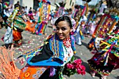 A dancer danzante, holding flowers, takes part in the religious parade within the Corpus Christi festival in Pujilí, Ecuador, 10 June 2012  Every year in June, thousands of people gather in a small town of Pujili, high in the Andes, to celebrate the Catho