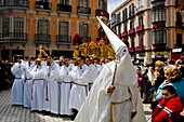 The large throne, with the Paso scene featuring Jesus Christ on the top, is carried in the street during the Holy Week fiesta in Malaga, Spain, 9 April 2007