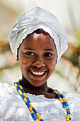 A young Baiana girl smiles during the ritual ceremony in honor to Yemanjá, the Candomblé goddess of the sea, in Cachoeira, Bahia, Brazil, 5 February 2012  Yemanjá, originally from the ancient Yoruba mythology, is one of the most popular 'orixás', the deit