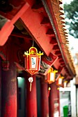 An ornamental lantern hanging from the roof at The Temple of Literature in Hanoi, Vietnam