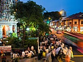 People walking along the roads in Little India at night with an Indian temple on the left  Little India in Singapore, a focal gathering point for Indians local and foreign  Foreign indians, who make up a sizable proportion of foreign labour in Singapore g