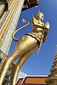 Statue of Kinnari, traditional symbol of feminine beauty at Wat Phra Kaeo, the Royal Grand Palace, Bangkok,Thailand