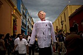 A giant paper mache puppet, known as ´Mono de Calenda, dances dressed as a husband as part of a wedding in Oaxaca, Mexico, July 14, 2012  Oaxaca commemorates the ´Guelaguetza,´ an annual celebration by all seven of the state´s regions, as they converge on