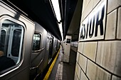 Subway departs from Astor station, New York