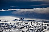 Grimsvotn Volcanic Eruption in the Vatnajokull Glacier, Iceland  Ash seen in the clouds, snow, and ice approx 20-40 kilometers away  The eruption began on May 21, 2011 spewing tons of ash, initially the plume was over 20 kilometers high  Volcanic ash is a