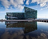 Harpa Concert Hall and Conference Center, Reykjavik Iceland  Situated on the boundary between land and sea, the building is a gleaming sculpture reflecting both sky and harbor  The glass facade was designed by Olafur Eliasson in collaboration with Henning