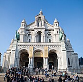 Crowd of People gather at the steps of the Basilica to enjoy the view and street performers