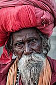 Old shadu wearing a big turban  Varanassi, India