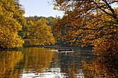 Lake in Tiergarten in autumn with rowing boats, Berlin Center, Berlin, Germany