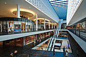 Interior view of a shopping center with escalator, Centrum Galerie, Dresden, Saxony, Germany