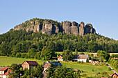 Houses and meadows in front of Pfaffenstein, Elbe Sandstone mountains, Saxon Switzerland, Saxony, Germany, Europe