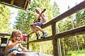 Mother and daughter playing music, Plankenstein hut, Plankenstein, Rottach-Egern, Bavaria, Germany