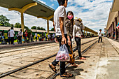 Young Vietnamese people at Hue railway station, Vietnam, Asia