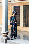 Young woman wearing fashionable traditional clothes in the Thien Hau pagoda in Saigon, south Vietnam, Vietnam, Asia