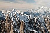 Aerial view of snow swept peaks and sheer granite walls in the Alaska Range in Denali National Park & Preserve, Interior Alaska, Summer
