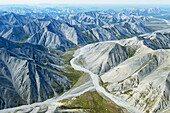 Aerial of the rugged Philip Smith Mountains portion of the Brooks Range in ANWR, Arctic Alaska, Summer, HDR