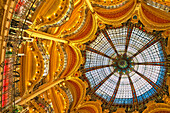 The stained glass dome of Galleries Lafayette, a large opulent art nouveau and historic department store in the centre of Paris