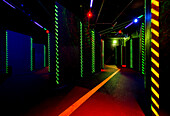 Laser game area with obstacles and hide-outs, with lasers and low lighting, Walls and narrow alleys