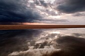 Storm Clouds Reflected In Water