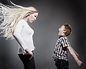Boy Yelling At His Mother As Her Hair Blows Wildly