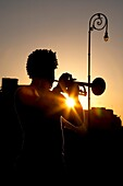 Havana, Cuba, Silhouette Of Man Playing Trumpet At Sunset