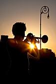 Havana, Cuba, Silhouette Of Man Playing Trumpet At Sunset
