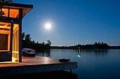 Lake Of The Woods, Ontario, Canada, Cabin Along The Lake At Night