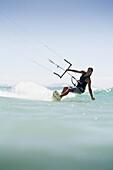 Woman kitesurfing in costa de la luz, tarifa, cadiz, andalucia, spain