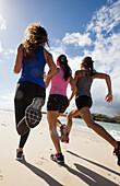 Three women running, gold coast queensland australia