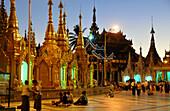People sitting in front of the Shwedagon Pagoda, Yangon, Myanmar, Burma, Asia