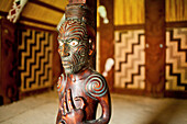 blocked for illustrated books in Germany, Austria, Switzerland: Carved wooden ancestral sculpture with spiral tatoos in the Maori traditional meeting house at Okains Bay, carved meeting house representing all tribes, Te Whare Runanga, Okains Bay, Banks Pe