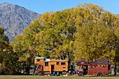 blocked for illustrated books in Germany, Austria, Switzerland: Wooden house trucks at Lake Hayes, alternative way of life, Lake Hayes, Otago, South Island, New Zealand