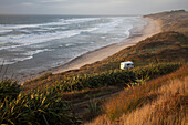 Camper van parked on a secluded beach along the West coast, South Island, New Zealand